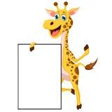 摆在与空白的标志的动画片长颈鹿 库存图片