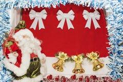 摆在与袋子的圣诞老人在圣诞节背景的礼物 库存照片