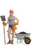 摆在与铁锹的女工 免版税库存图片