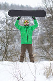 摆在与雪板的明亮的衣裳的挡雪板 免版税图库摄影