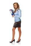 摆在与黏合剂的可爱的女实业家 免版税库存照片