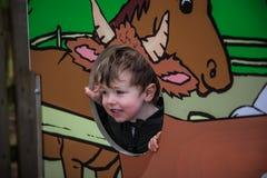 摆在与&#x22的小男孩; animals' 库存照片