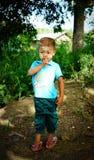摆在为照相机的缅甸男孩 库存照片