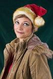 摆在作为圣诞老人的美丽的妇女 免版税库存照片