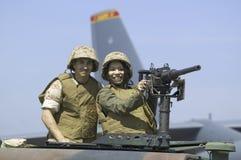 摆在作为炮兵的亚裔美国人女孩 免版税库存照片