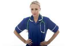 摆在作为医生或护士的可爱的少妇 免版税库存图片