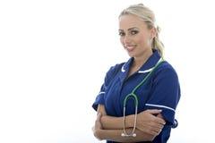 摆在作为医生或护士的可爱的少妇 免版税图库摄影