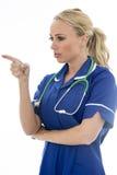 摆在作为医生或护士的可爱的少妇 库存照片