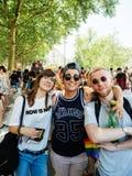 摆在同性恋自豪日的快乐朋友在法国 库存照片