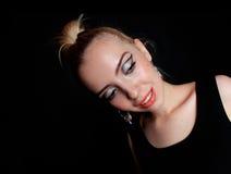 摆在和跳舞在黑背景的演播室的小姐 库存图片