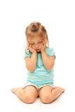 摆在哀伤的年轻人的女孩 免版税库存照片