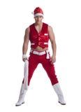 摆在圣诞老人庆祝服装的人 免版税图库摄影