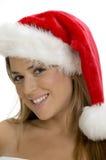 摆在圣诞老人微笑的盖帽夫人 免版税库存图片