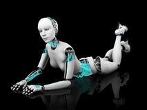 摆在地板nr 2.的性感的机器人妇女。 免版税库存图片