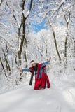 摆在多雪的风景的少妇 库存图片