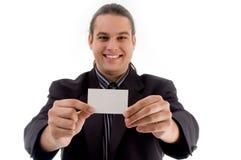 摆在年轻人的名片执行委员 免版税库存照片