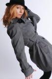 摆在性感的妇女的夹克 免版税库存照片