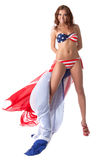 摆在有美国国旗的泳装的微笑的女孩 库存图片