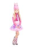 摆在桃红色小马衣服的美丽的女孩 免版税库存照片