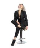 摆在椅子的企业女孩 免版税库存照片