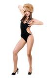 摆在泳装和毛皮盖帽的性感的夫人 图库摄影