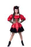 摆在海盗服装的可爱的女孩在万圣夜 免版税图库摄影