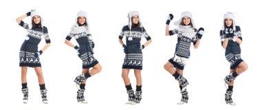 摆在温暖的冬天衣裳的愉快的妇女隔绝在白色 免版税库存照片