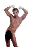 摆在演播室的咧嘴笑的英俊的跳脱衣舞者 免版税库存照片