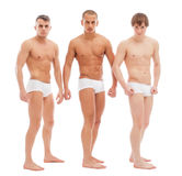 摆在白色摘要的英俊的赤裸人 库存图片