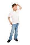 摆在白色的男孩 免版税图库摄影