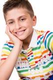 摆在白色的男孩 免版税库存照片