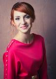 摆在红色礼服的妇女 图库摄影