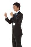 摆在胆量的新生意人 免版税库存图片