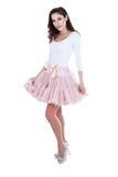 摆在芭蕾舞短裙的妇女 免版税库存图片