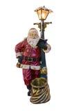 摆在袋子附近的圣诞老人的全长画象隔绝在白色背景 图库摄影