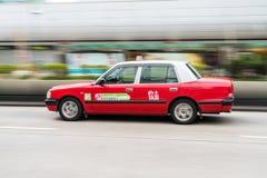 摇摄被射击一辆出租汽车在香港 库存照片