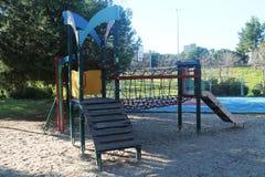 摇摆和操场孩子的在公园 免版税图库摄影