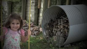 摇摆在摇摆的小女孩的慢动作 股票录像