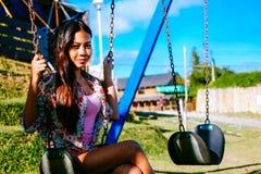 摇摆在摇摆的美丽的亚裔妇女 库存照片
