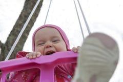 摇摆的愉快的小女孩 图库摄影