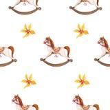 摇摆马玩具和花无缝的样式 免版税库存图片