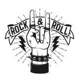 摇滚乐标志 有重金属的标志的人的手 免版税库存照片