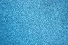 摘要蓝色织地不很细皮革背景 免版税库存照片