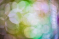 摘要被弄脏蓝色和银色闪烁的亮光电灯泡光背景:圣诞节墙纸装饰概念迷离  xmas 库存图片