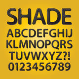摘要被环绕的黑树荫字体和数字 免版税图库摄影