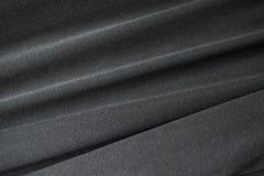 摘要黑织地不很细纺织品,宏指令 免版税库存照片