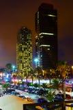 摩天大楼夜视图从口岸的在巴塞罗那 库存图片