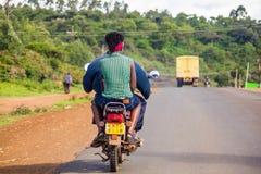 摩托车出租汽车的妇女 免版税库存照片