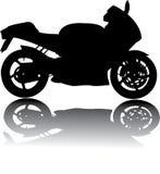黑摩托车剪影  免版税库存图片