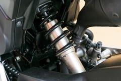 摩托车吸收的一个设备颠簸的缓冲器 免版税库存图片